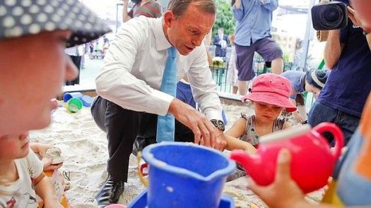Tony Abbott shows his softer side at a Brisbane childcare centre last week. Photo: Glenn Hunt